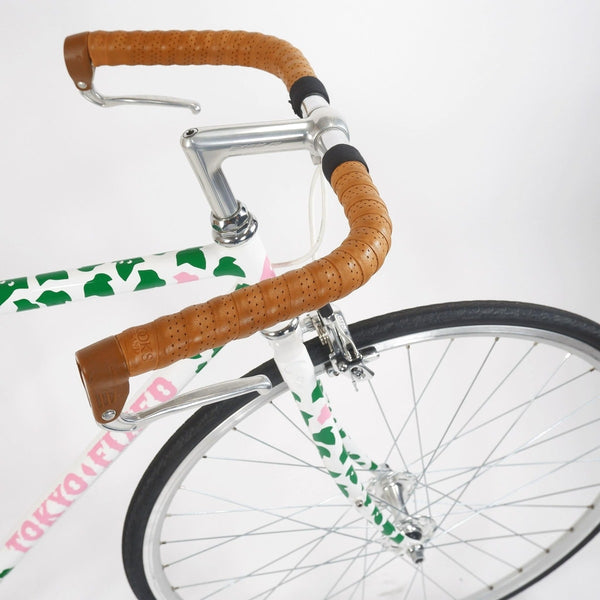 Tokyo fixed single speed bike, white with green leaves 50cm, handlebars with brown grips and the front half of the bike