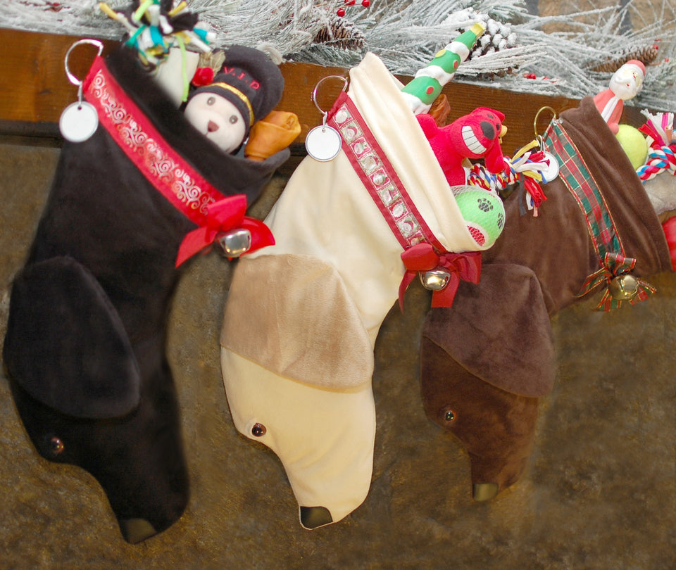 These Labrador Retriever shaped Christmas dog stockings are perfect for stuffing toys and treats into to spoil your fur baby for Christmas, or whatever holiday you celebrate!