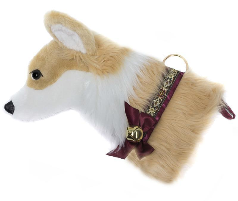 This Corgi dog Christmas stocking is the perfect gift for stuffing toys and treats into to spoil your fur baby for Christmas, or whatever holiday you celebrate!