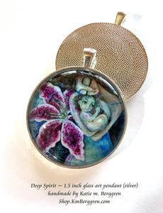 mother and big eyed toddler with stargazer lily glass art pendant necklace mothers gift 1.5 inches across handmade by the artist