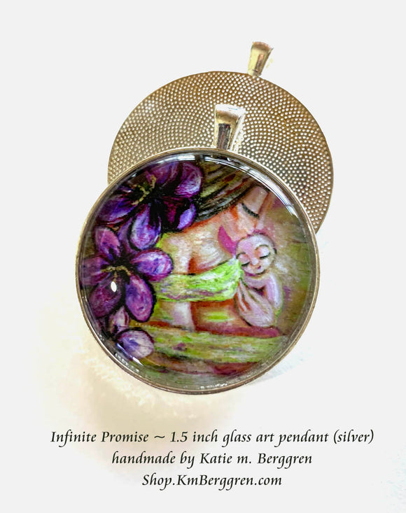 mother with brand new baby and crocuses glass art pendant necklace mothers gift 1.5 inches across handmade by the artist