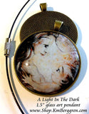 mother nursing baby in the night glass art pendant handmade by the artist