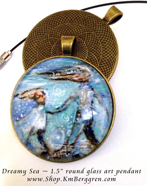 mother and child on the beach glass art pendant 1.5 inches across handmade by the artist