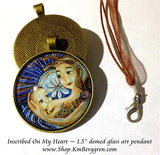 1.5 inch glass art pendant of mother nursing baby with big blue flower, handmade by artist KmBerggren