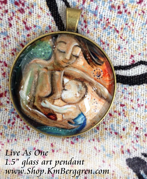 glass art pendant of biracial mother nursing lighter skin baby 1.5 inches across handmade by the artist