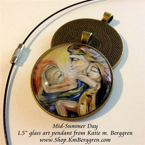 glass art pendant necklace of mom wearing baby and carrying girl on her back 1.5 inches across handmade by the artist