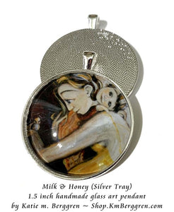 glass art pendant necklace of happy mommy with little girl and bird 1.5 inches across handmade by the artist
