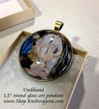 mother holding child in the rain glass art pendant necklace mothers gift 1.5 inches across handmade by the artist