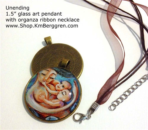 mother holding twin babies glass art pendant necklace mothers gift 1.5 inches across handmade by the artist