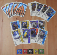 Top view of the Bruges Pets mini expansion, showing all the cards and tokens.