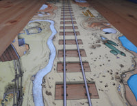 Side view of the play mat, looking down the tracks off into the Wild West!