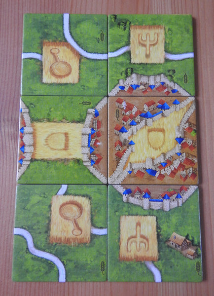 Front view of the 6 tiles included in this Carcassonne Corn Circles II mini expansion.