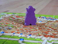 Close-up view of the brooding Count meeple figure as he stalks the streets of the city of Carcassonne. Scary!