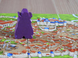 Close-up of the Count meeple figure stalking the streets of Carcassonne. Residents: beware!