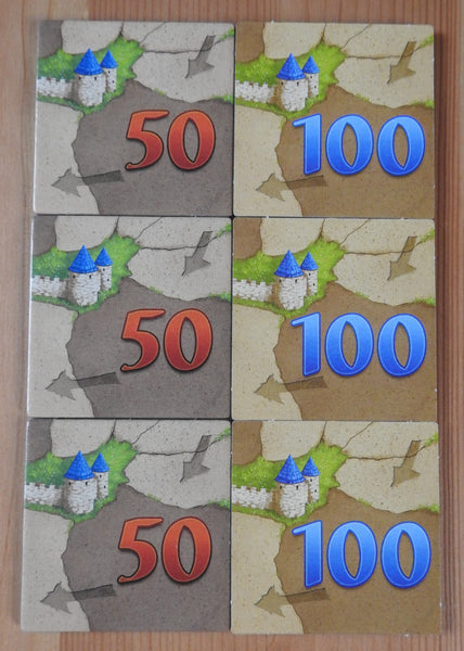 Top view of the 6 counting tiles included, each with '50' or '100' on either side.