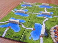 Another close-up of the ferries tiles, with the wooden ferry piece connecting the roads over water.