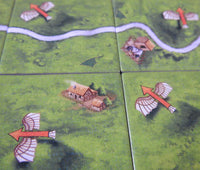 Close-up view of 4 tiles, showing the flying machines symbols.