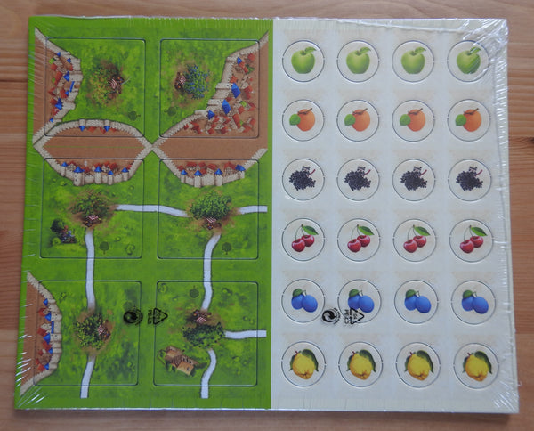 Front view of the Fruit Trees Carcassonne mini expansion, showing the 6 tiles and 24 counters.