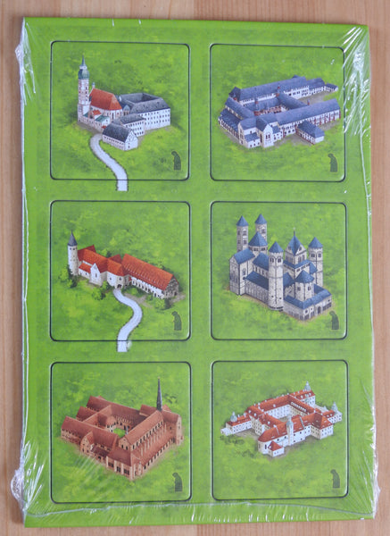 Front view of the 6 tiles included in this Carcassonne German Monasteries mini expansion.
