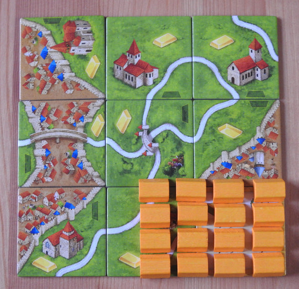 Top view showing the 9 gold mine tiles and the 16 wooden gold bar pieces that come with this expansion.