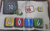 Close-up view of the 'B' start card showing the symbols and bonuses that aid players during the game.