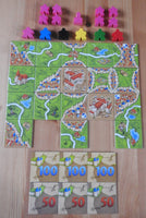 Top view of all the pieces included in this unboxed version of Carcassonne Inns & Cathedrals.