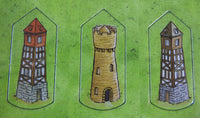 Close-up of 3 of the tower tokens.