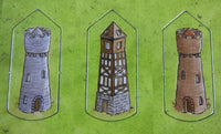 Close-up of 3 more tower tokens.