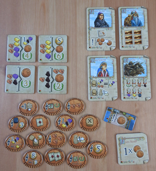 Top view showing the 4 new characters, 4 contracts, 15 goal tokens and 2 other tokens included with this Marco Polo - New Characters mini expansion.