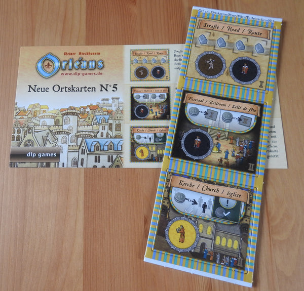 Top view of the 3 new place tiles and rules included with this Orleans - New Place Tiles No.5 mini expansion.