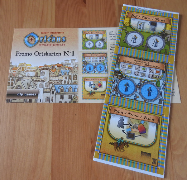 Top view of the 3 promo tiles and rules included with this Orleans - Promo Place Tiles No.1 mini expansion.