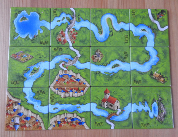 Top view of the 12 tiles that make up this river I Carcassonne mini expansion.