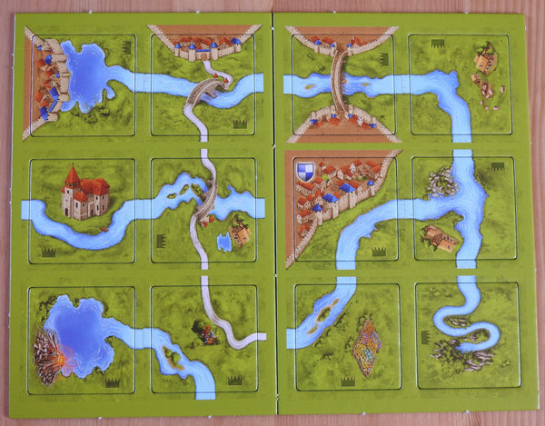 Top view of the 12 tiles that come with this River II Carcassonne Mini Expansion.