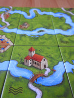 Another close-up view of some of the tiles, these ones showing a monastery on the river bank next to a bridge.