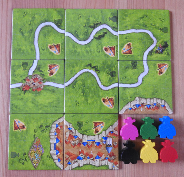 Top view of the 8 tiles and 6 robber mini meeple figures that are included in the Carcassonne Robbers expansion.