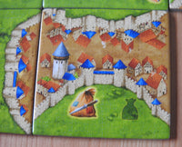 Close-up view of one of the included tiles, this one showing a city.