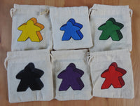 Close-up of the all 6 meeple bag colours to choose from.
