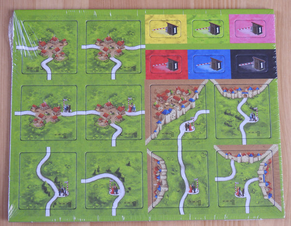 Top view of the 10 tiles and 6 toll tokens that come with this Tollkeepers Carcassonne Mini Expansion.