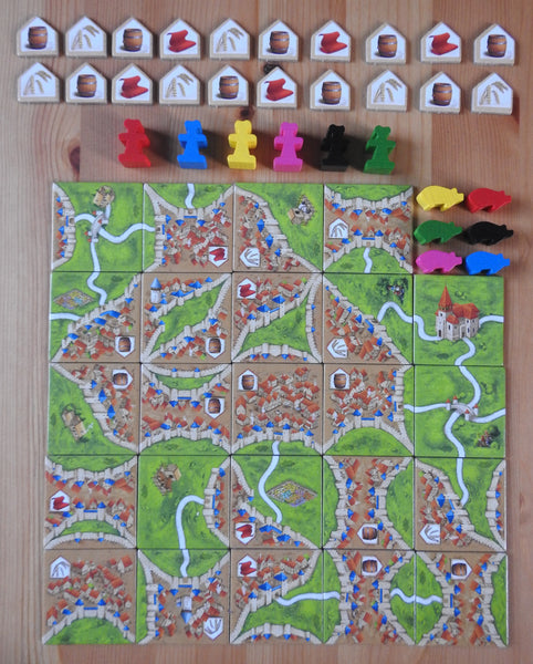 Top view showing all the tiles, pieces and tokens included in this Traders & Builders Carcassonne expansion.