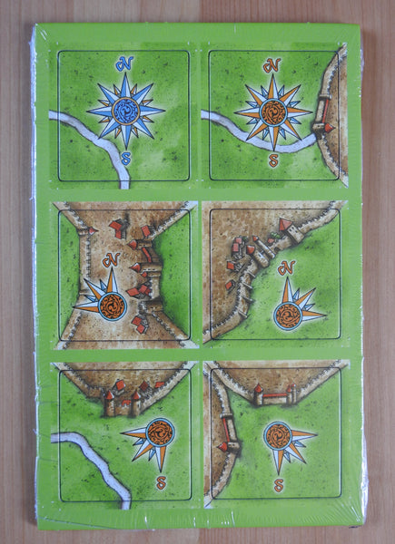 Top view of the 6 windroses tiles making up the Windroses Carcassonne Mini Expansion.