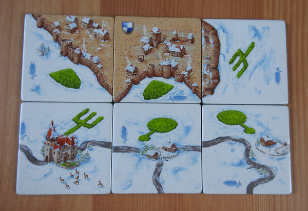 Top view of the 6 Winter tiles that come with the Winter Corn Circles Carcassonne Mini Expansion.