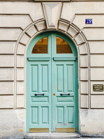 Mint green door topped with half-circle windows in Paris, France