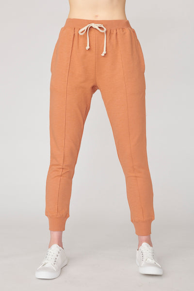 woman wearing organic cotton trackpants, with organic loungewear clothing