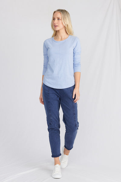 Model in womens loungewear, with organic cotton top and organic jeans
