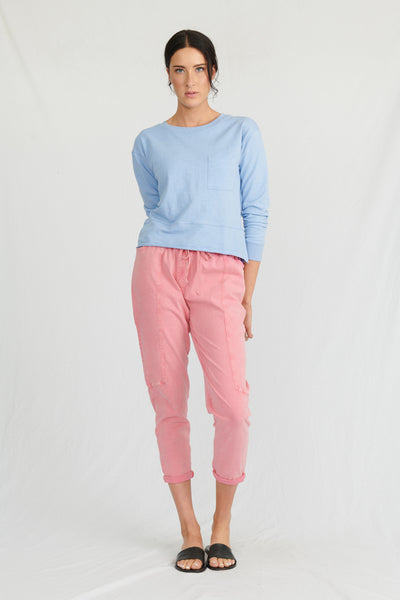 Model wearing organic cotton sweatshirt, with organic pants
