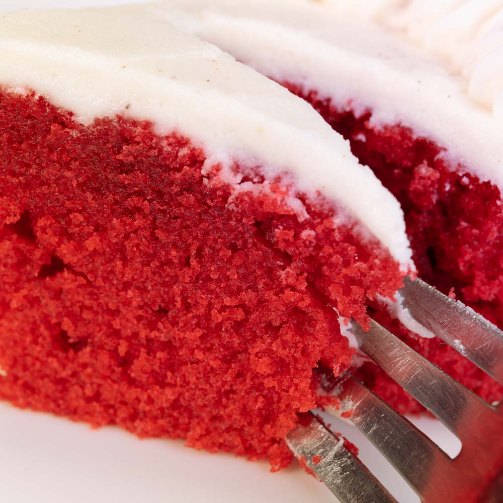Red velvet cake with a fork through it