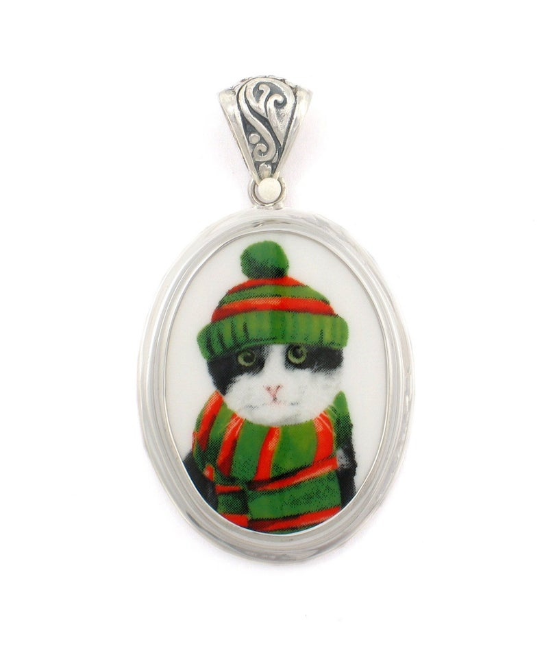 Broken China Jewelry Black and White Winter Cat in Green and Red Hat & Scarf Sterling Oval Pendant