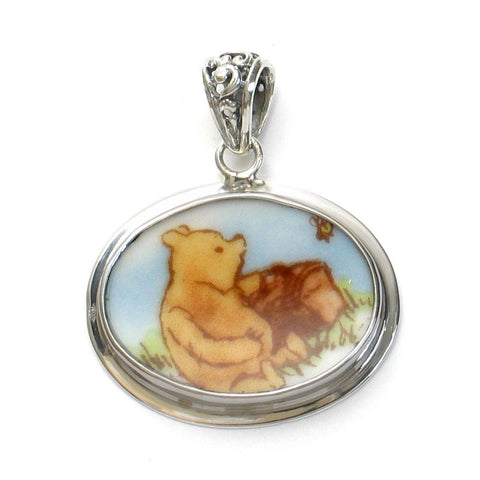 Broken China Jewelry Classic Pooh Bear Winnie The Pooh with a Picnic Horizontal Oval Sterling Pendant - Vintage Belle Broken China Jewelry