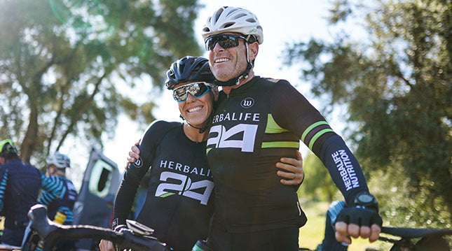 Elite triathlete Heather Jackson (left) and Michael at a recent cycling event.