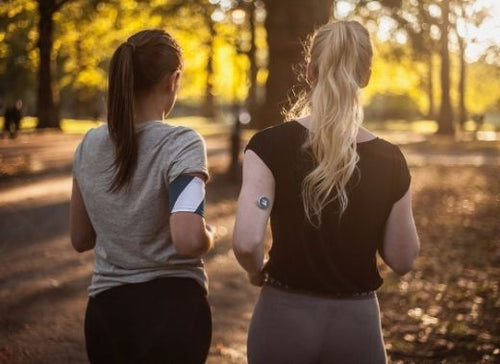 two women running in the woods with myLevels sensors on